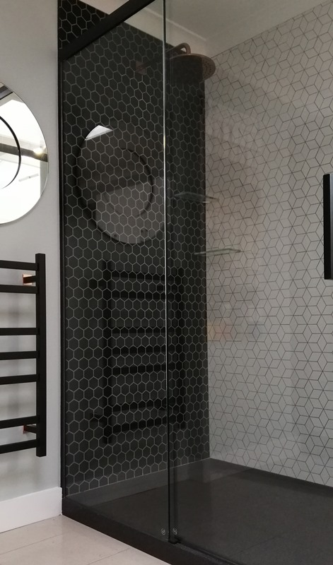 Crest Lacuna Stone tiled shower installation by Bay Bathroom Design and Build, your one stop shop for Bathroom renovation in Tauranga, Bay of Plenty. Featuring Heirloom heated towel warmer and rose gold plumbing fittings